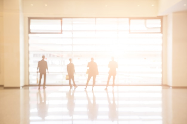 Blurred background of businesspeople standing in the corridor of an business center