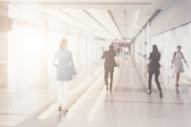 Blurred background of businesspeople walking in the corridor of an business center