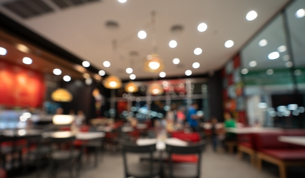 Blurred background of customer sitting in coffee shop or cafe restaurant with bokeh light.