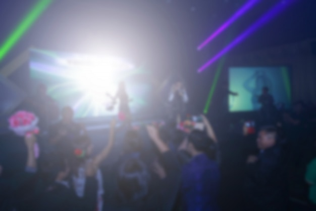 Blurred background of event concert or award ceremony with lighting at conference hall