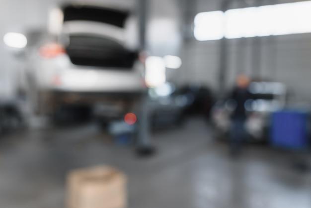 Размытый фон центра технического обслуживания автомобилей