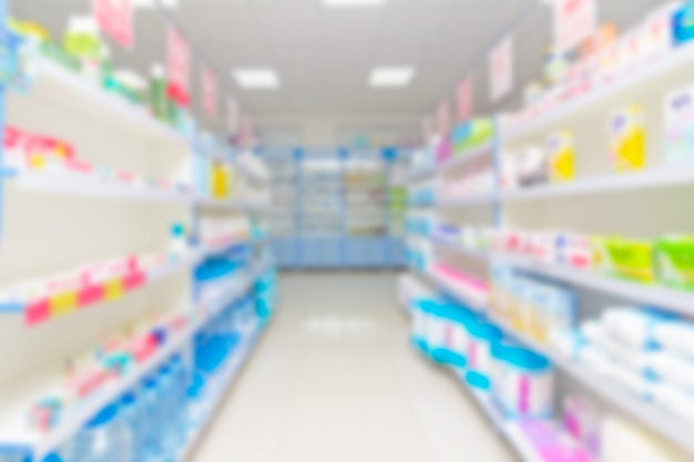 Blurred background with goods on shelves in a pharmacy minimarket