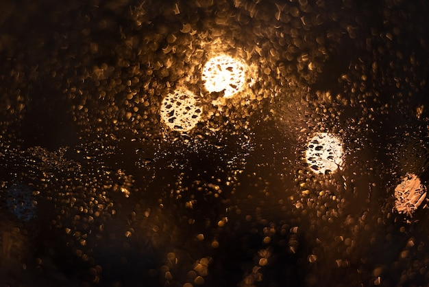 Blurred background with raindrops and lights