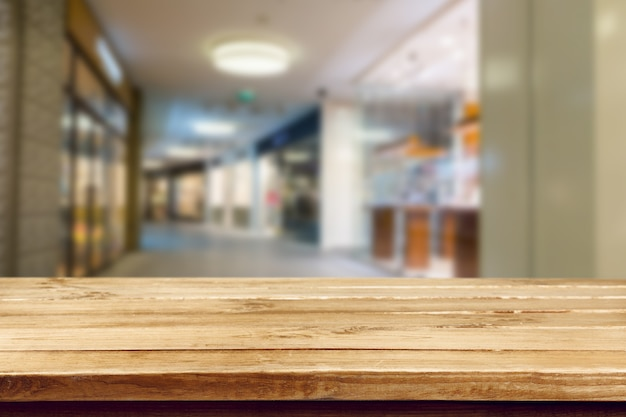 Blurred background and wooden textured table
