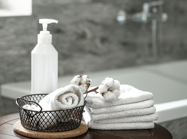 Blurred bathroom interior and set of clean folded towels copy space. hygiene and health concept.