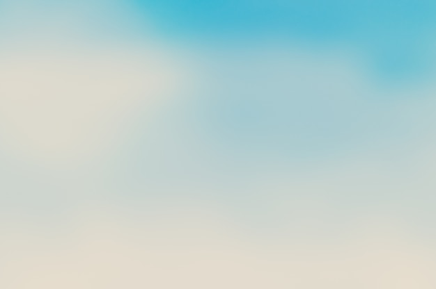 Размытое голубое небо и море хорошо использовать как. blur фоне океана concept.blurry пастель, цветной солнце