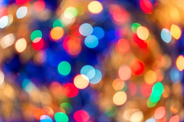 Blurred bokeh christmas lights in warm tone