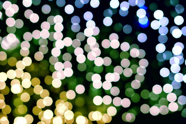 Blurred and bokeh of cool colors tone led lighting in full screen and black background.