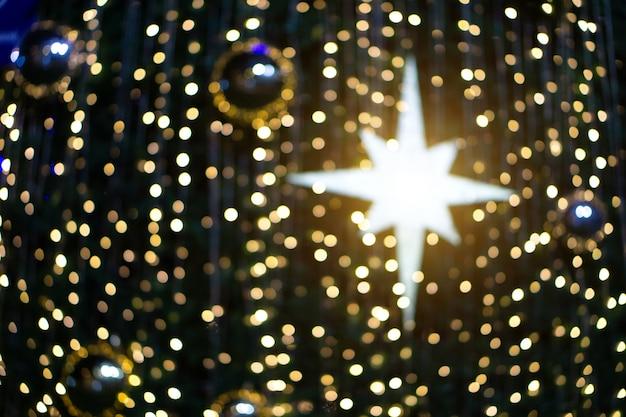 흐리게 Bokeh 반짝이 크리스마스, 크리스마스 휴일. 프리미엄 사진