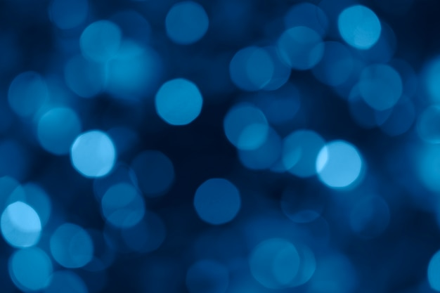 Blurred bokeh lights toned color of the year 2020 classic blue