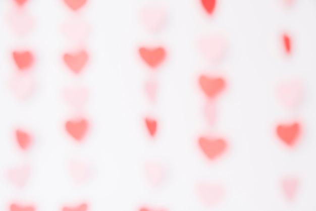 Blurred bright hearts background