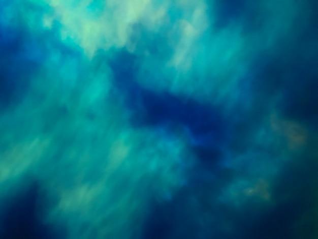 霧と雲とぼやけた明るいネイビーブルーとターコイズブルーの宇宙の背景。ぼかしとボケ味の抽象的なグラデーション銀河の背景。ノーザンライトまたはポーラーライトの壁紙。