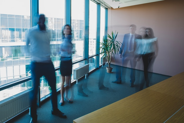 Blurred business people