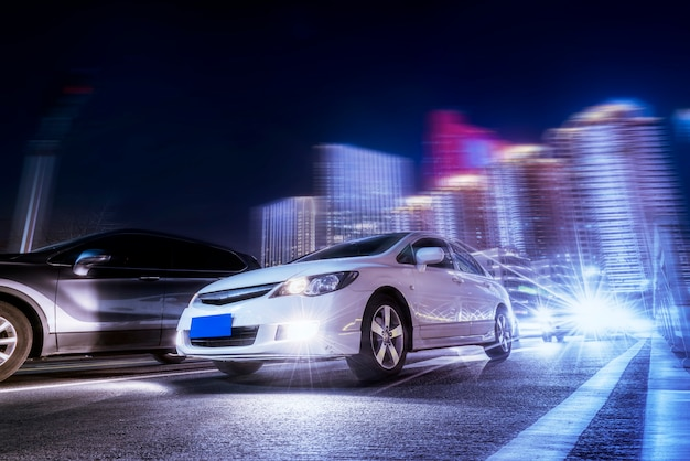 Blurred car lights and night views of urban architectural landscapes