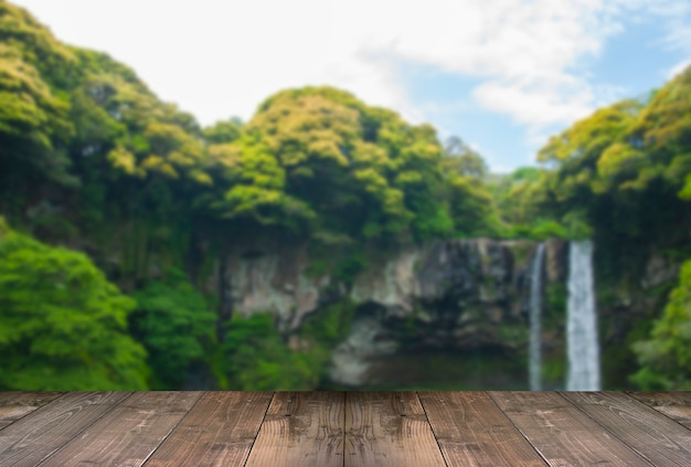 Blurred cheonjiyeon waterfall is a waterfall on jeju island, south korea with wooden bridge.