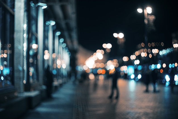 Blurred city at night. bokeh. beautiful abstract background with defocused buildings, cars, city lights, people