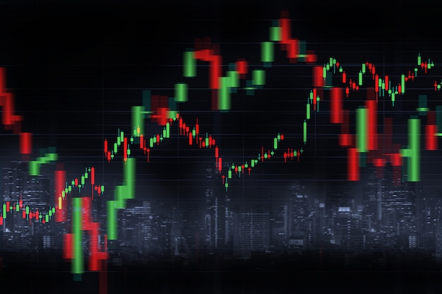 Blurred city skyline background and financial graph with candlestick chart in stock market on black color