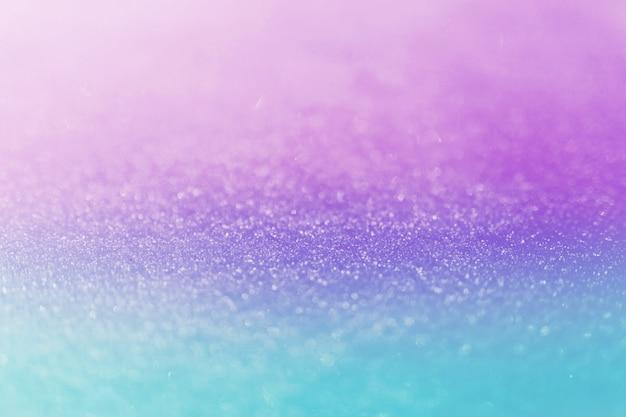 Размытый цветной снег. блестящее боке. фон или текстура.