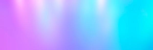 ライトからぼやけたカラフルな色とりどりの背景。虹色のホログラフィック抽象的な明るいネオン色の背景。バナー