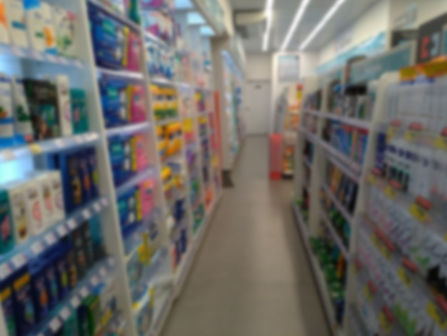 Blurred corridor of pharmacy with shelves of products pharmacy abstract corridor perspective