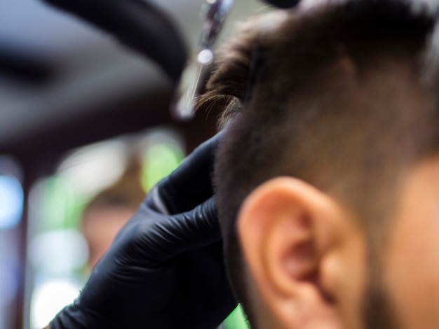Blurred customer and new haircut