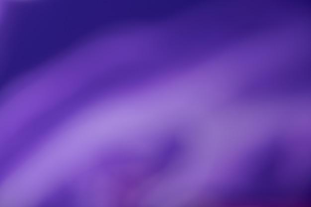 Размытый темно-фиолетовый и темно-синий фон с волнистым узором.