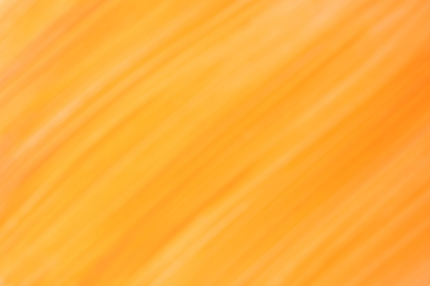 Blurred dark yellow and orange background with lines pattern. defocused art abstract golden gradient backdrop with blur and bokeh. blurry amber wallpaper.