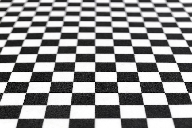 Blurred or defocused image of chess pattern, black and white background image