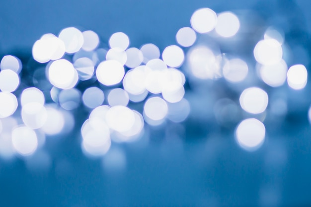 Blurred fairy lights on blue