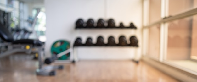 Blurred of fitness gym background for banner fitness exercise concept