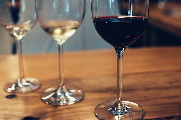 Blurred glasses with wine for tasting