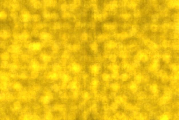 Blurred golden circle bokeh shape wall background.
