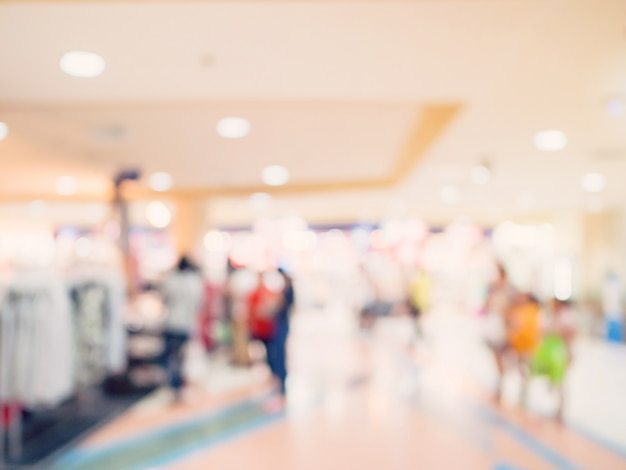 Blurred image background, people at shopping mall blur background with bokeh and vintage tone.