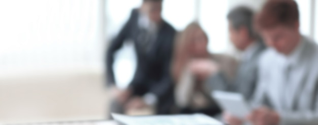 Blurred image of business team in office.business background