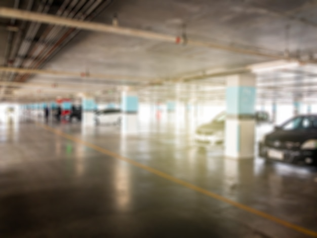 Blurred image of car park lot in building