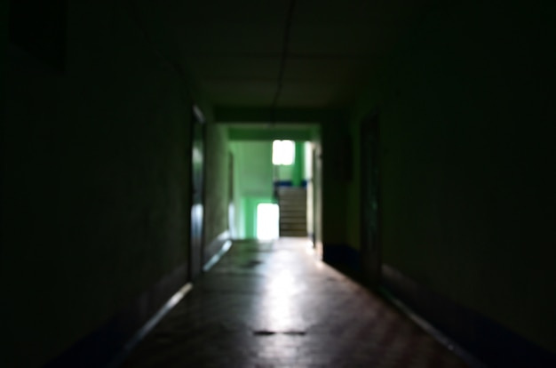 The blurred image of gloomy corridor of a neglected public building.
