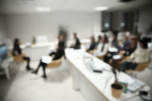 Blurred image of a large modern office.