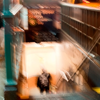 Blurred image of a man coming up the stairsway from the subway in manhattan, new york city, u.s.a.