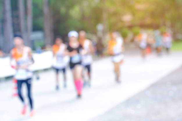 Blurred image of marathon racing with lans flare.blurry
