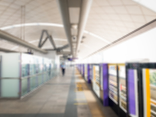 Blurred image of sky train platform in downtown