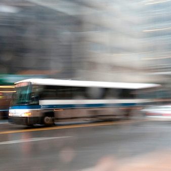 Blurred image of a transit bus in manhattan, new york city, u.s.a.