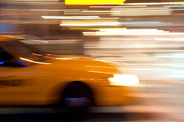 Blurred image of a yellow taxi in manhattan, new york city, u.s.a.