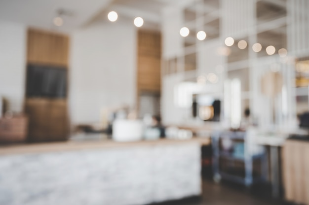 Blurred images of the coffee shop interior background and lighting bokeh