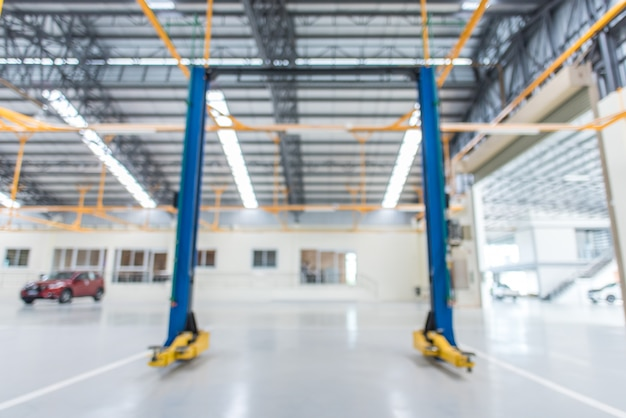 Blurred images of electric lifts for cars in service