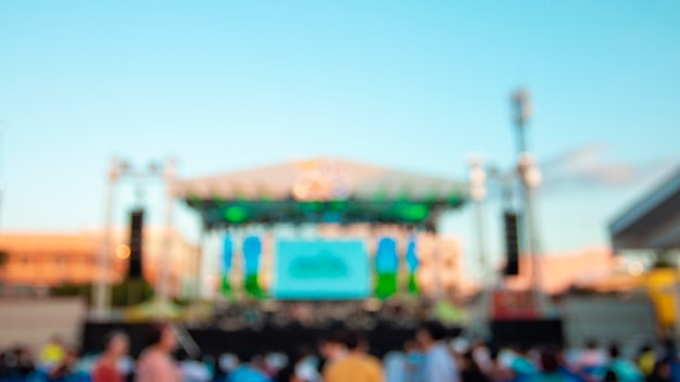 Blurred images of an empty concert stage in the evening.