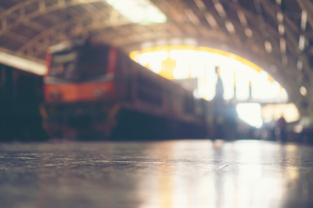 Blurred images of people in the train station