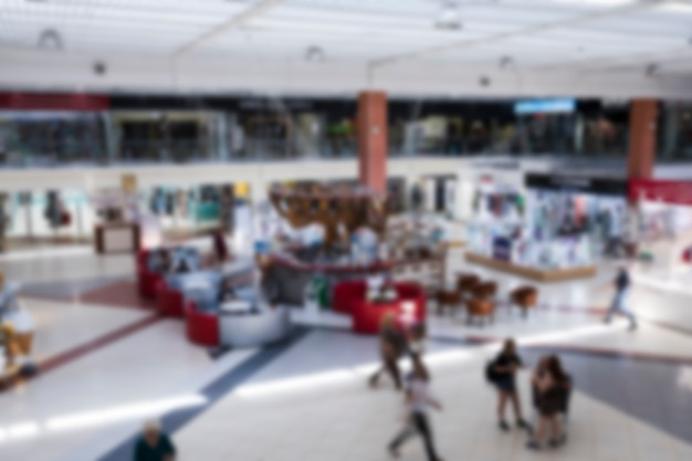 Blurred indoor shopping center from above