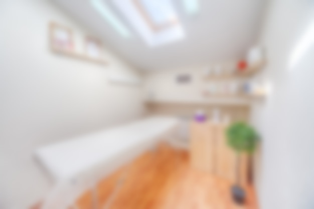 Blurred interior of abstract beauty salon room for procedures