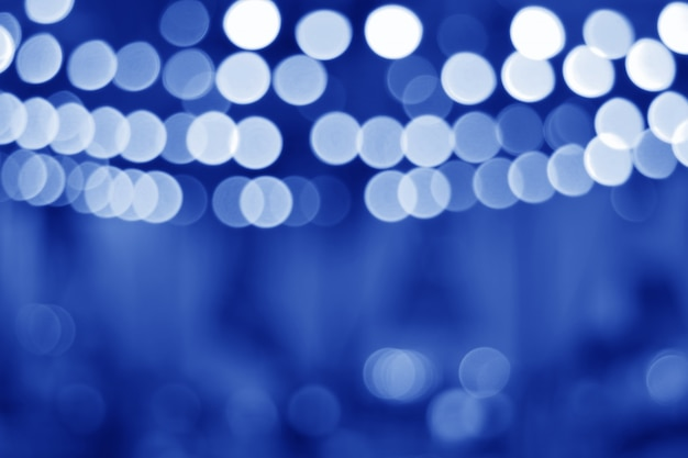 Blurred interior decorated lights of a cafe restaurant in blue color gradation