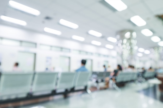 Blurred interior of hospital or clinical with people - abstract medical background.